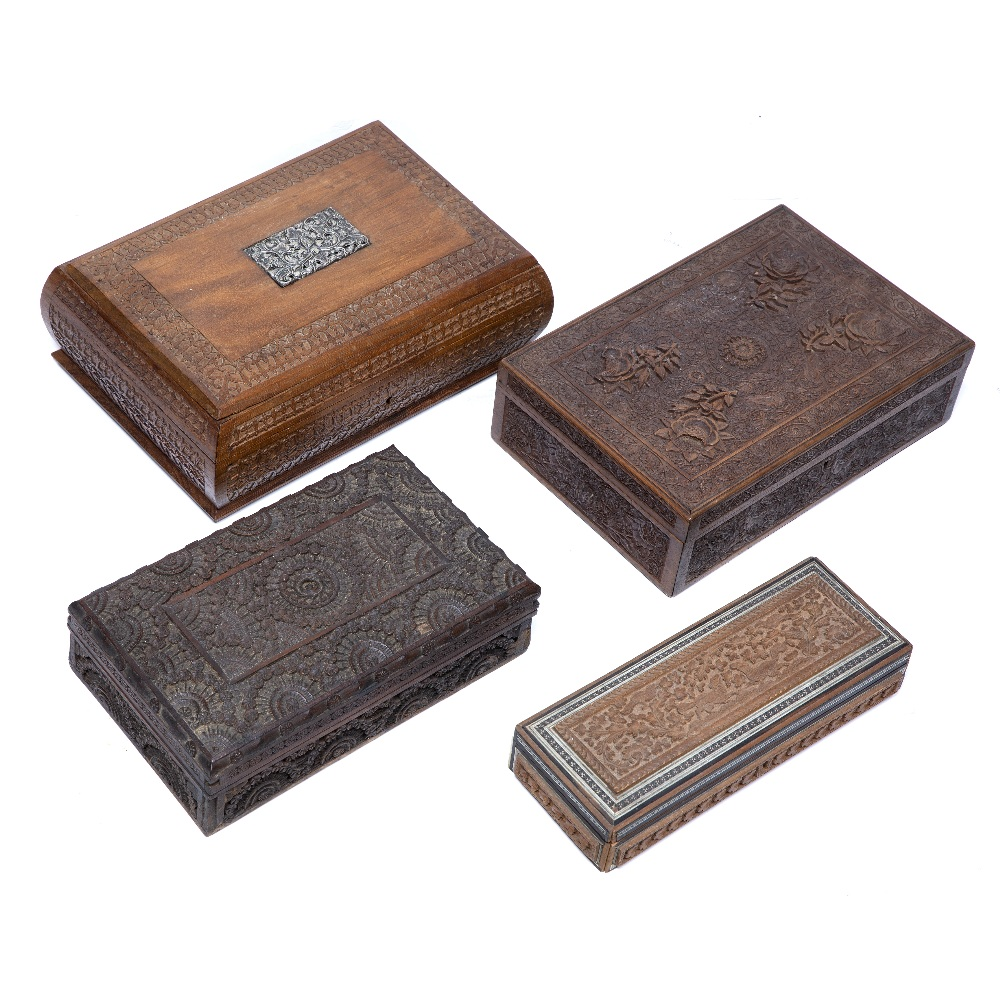 Lot 10 - Four wooden carved boxes India & Burma most carved with foliate patterns, one with an inset white