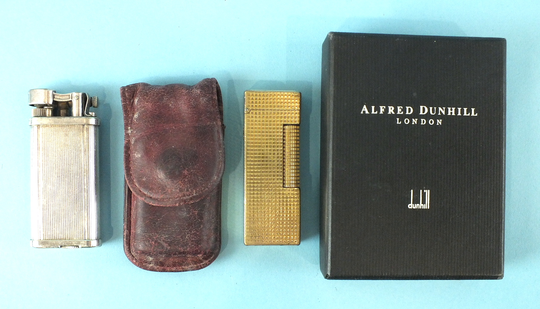 Lot 123 - A Dunhill 'Unique' lighter numbered 480735, in pouch and a Dunhill gold-plated lighter in worn