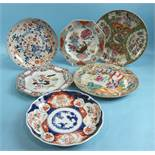 Two 18th century Chinese famille rose plates, a Chinese Imari saucer dish, two Canton plates and
