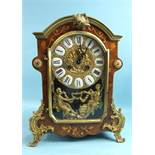 A reproduction marquetry and walnut-cased bracket clock in the French taste, the gilt metal and