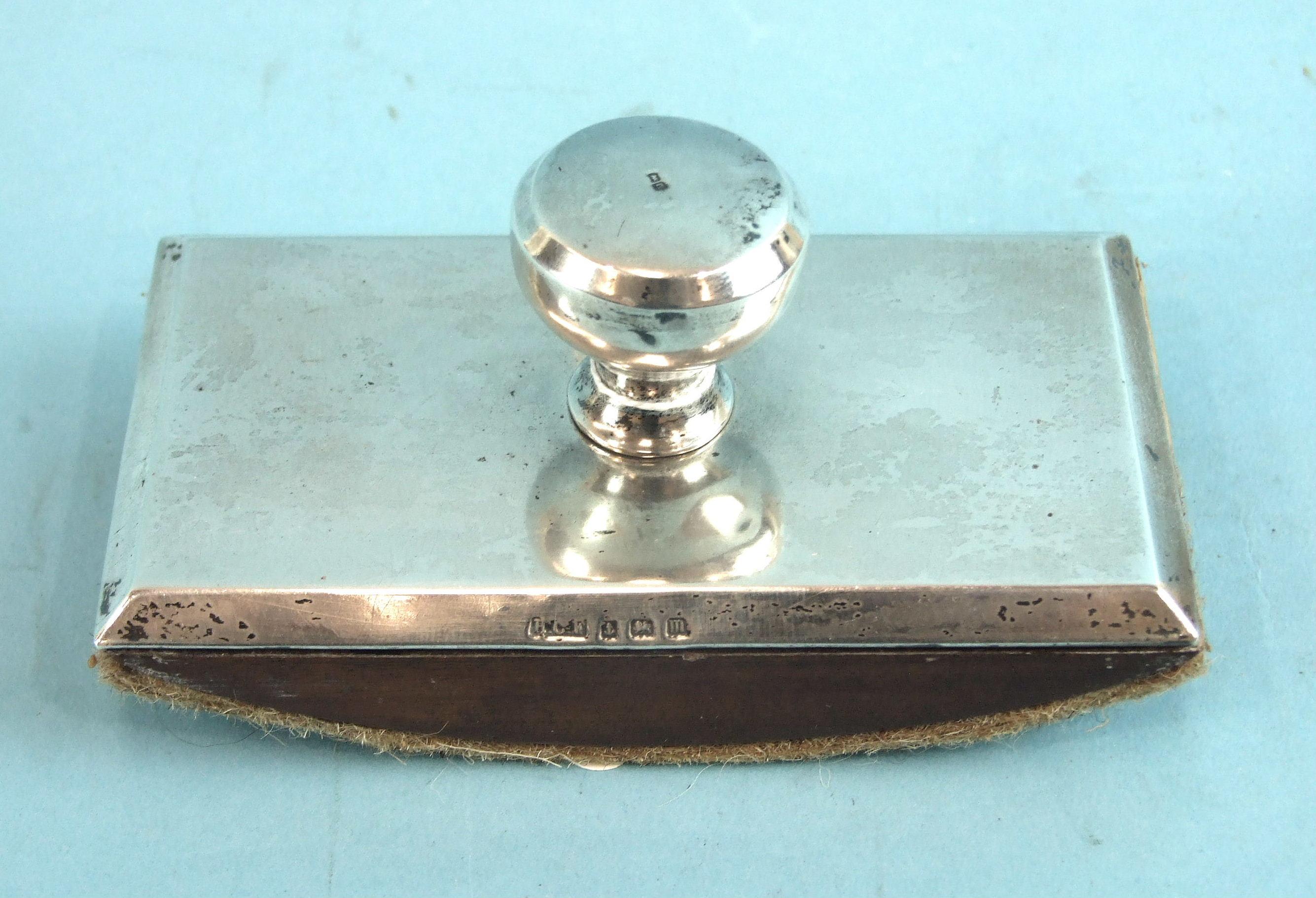 Lot 496 - A plain silver-topped blotter, Birmingham 1911, maker Henry Freeman, 11.5 x 6cm.