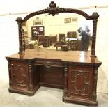A large Victorian mahogany sideboard, the mirrored back above an arrangement of drawers and pedestal
