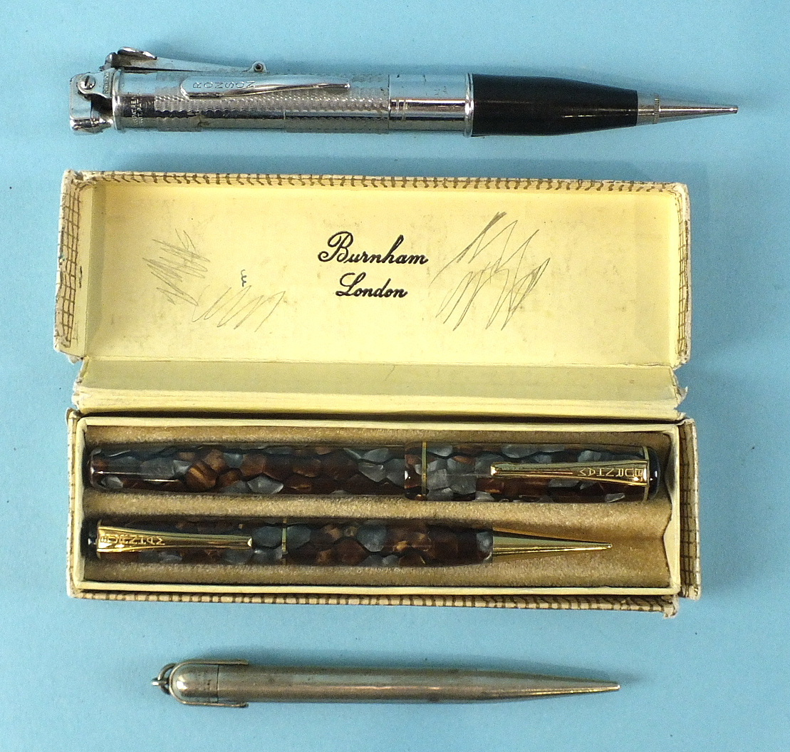 Lot 131 - A Burnham of London fountain pen and pencil set, marbled grey and brown, boxed, a Mabie Todd & Co,