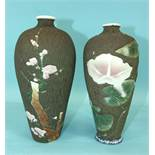 A pair of Japanese porcelain vases decorated with flowering lilies and prunus, on a wood-effect
