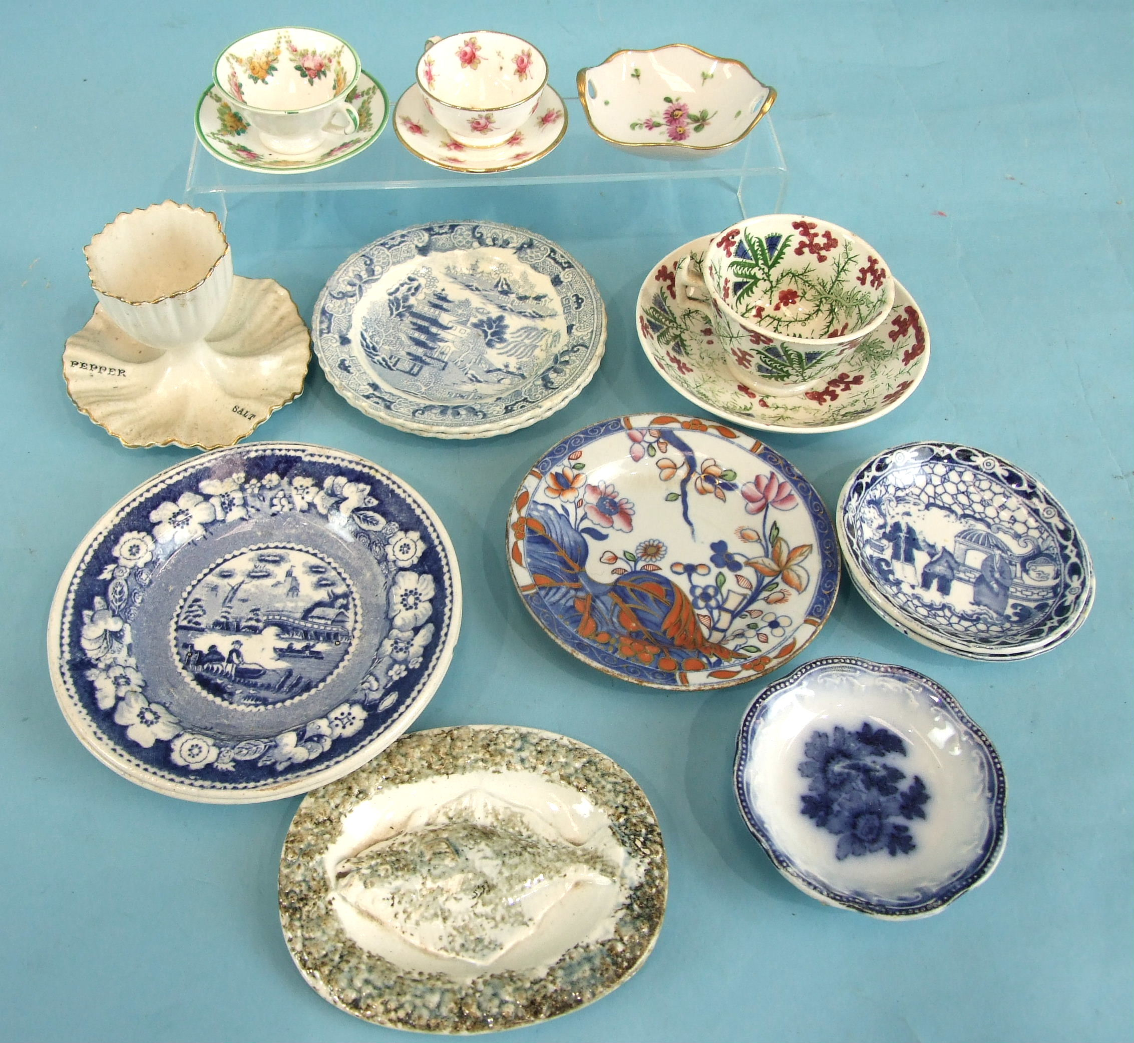 Lot 86 - A group of child's plates with willow pattern and other printed decoration, also an egg cup, etc.