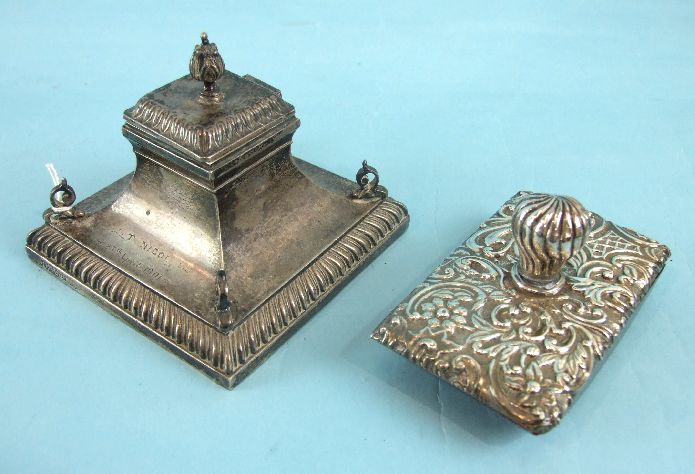 A late-Victorian loaded-silver inkwell of rectangular concave form, with gadrooned plinth and