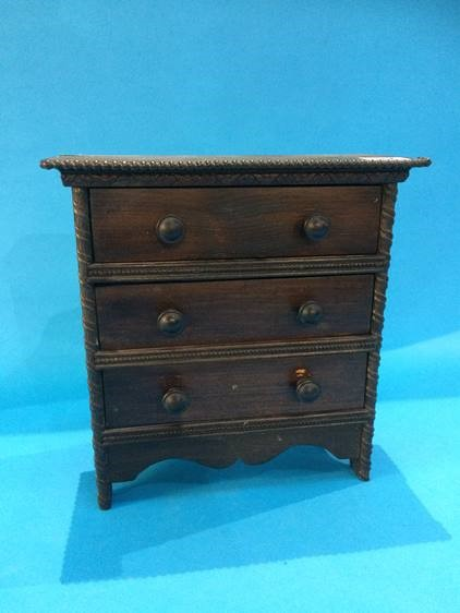 Lot 52 - A miniature oak chest of drawers