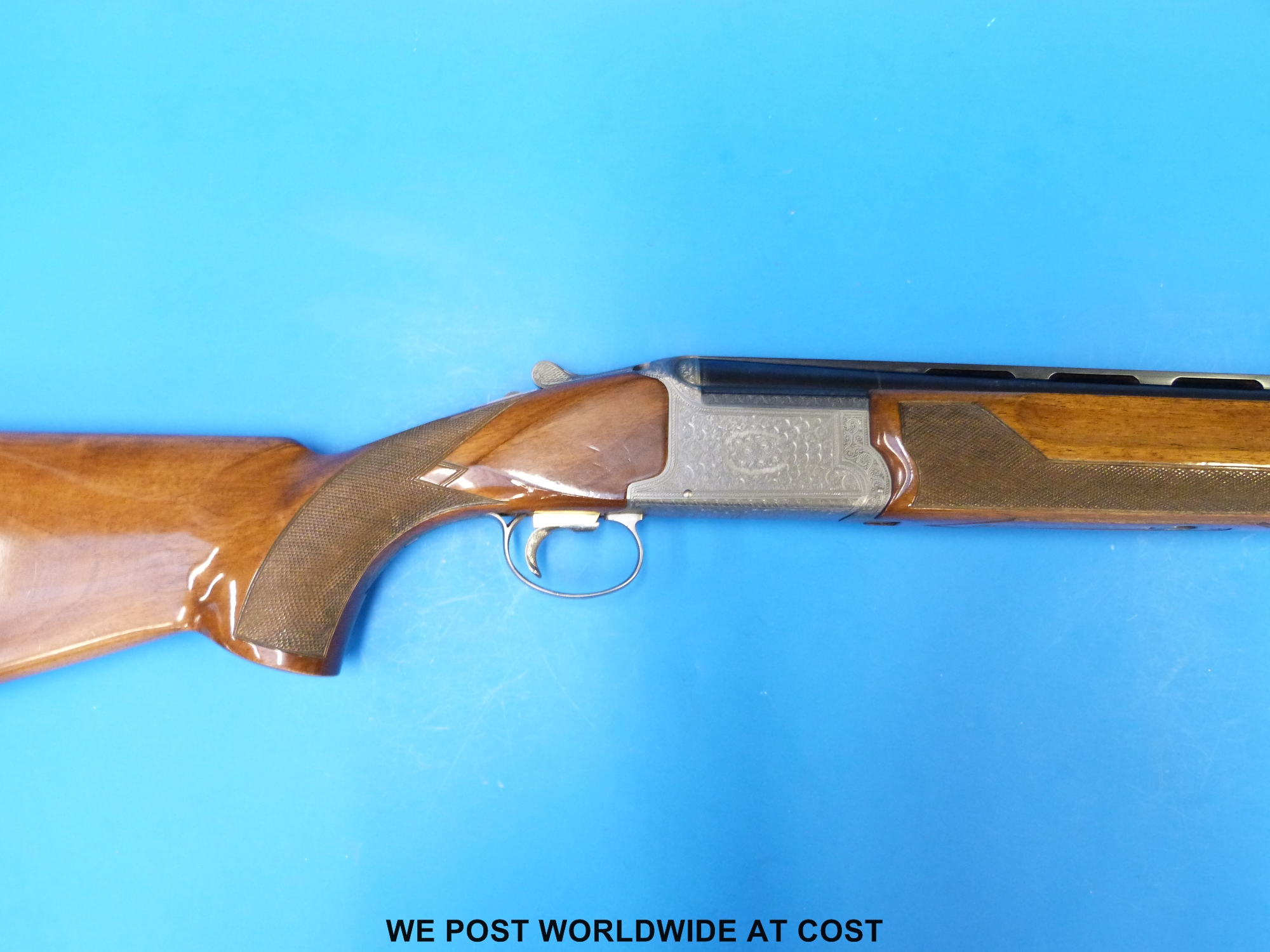Lot 1761 - Nikko 2500 12 bore over and under shotgun with floral and scrolling engraving to the locks,