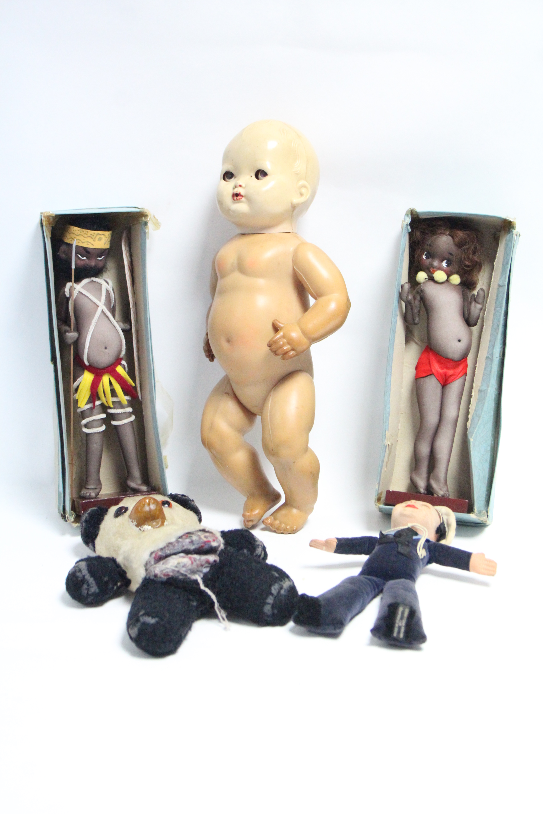 A Norah Wellings cloth sailor doll; two Brownie Downing Aboriginal stocking dolls, boxed, circa