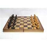 """A boxwood chess set of natural & ebonised stain (size of Kings 3½"""" high), with games box."""