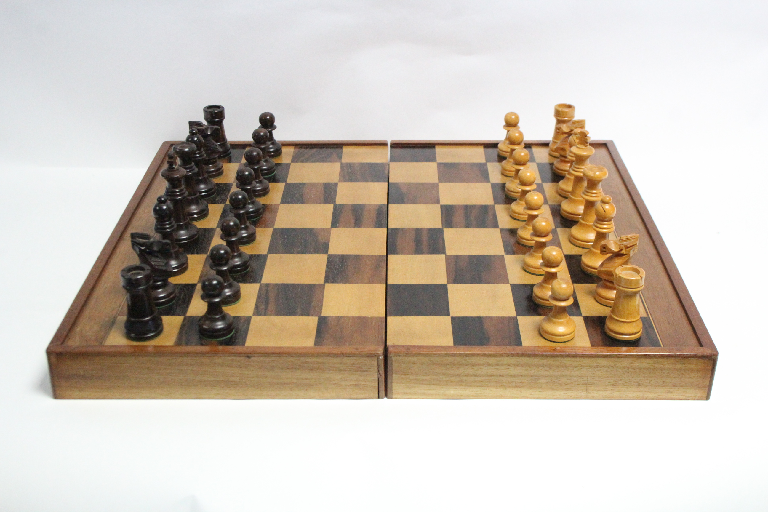 "A boxwood chess set of natural & ebonised stain (size of Kings 3½"" high), with games box."