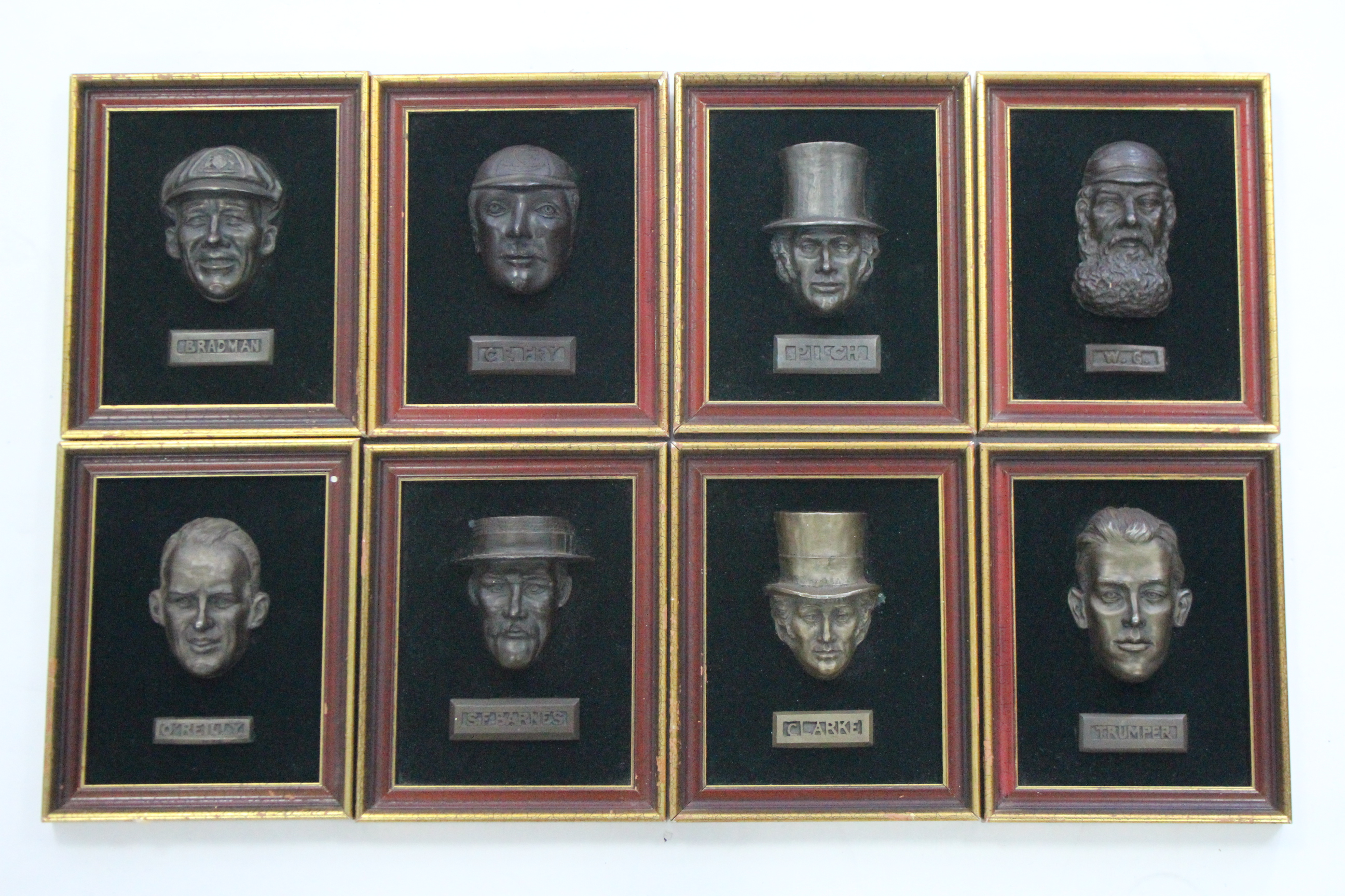 Lot 154 - A set of eight modern French composition plaques of vintage cricketers, each in gilt frame.