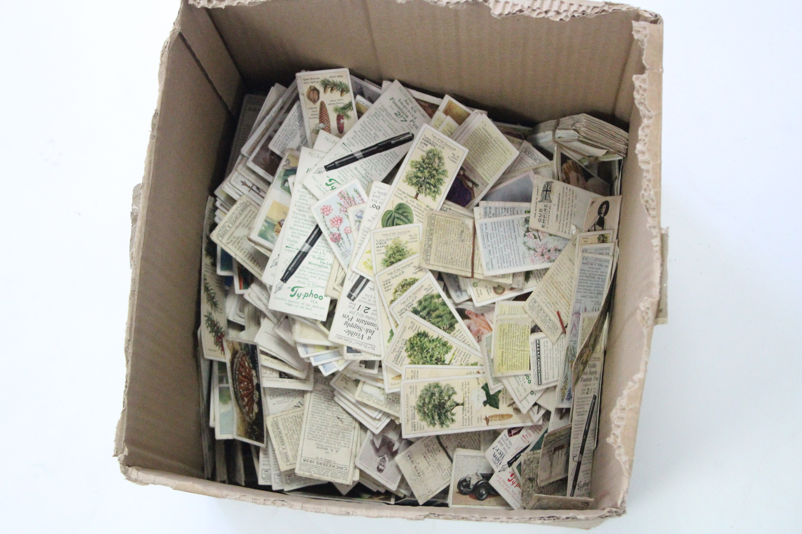 Lot 132 - A collection of assorted cigarette cards contained in nine albums & loose.