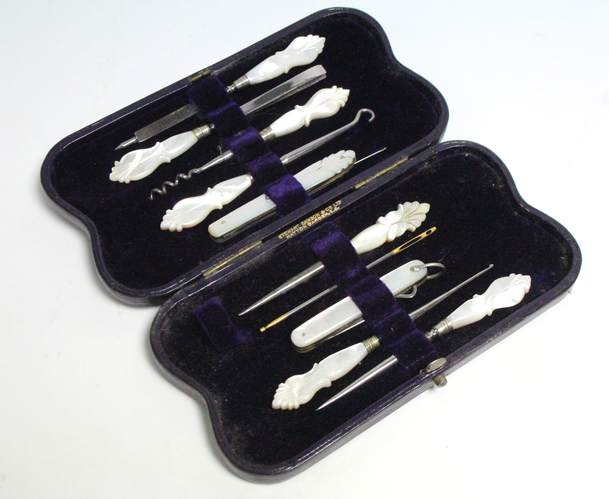 Lot 195 - A set of ten late 19th/early 20th century steel needlework implements, each with mother-of-pearl