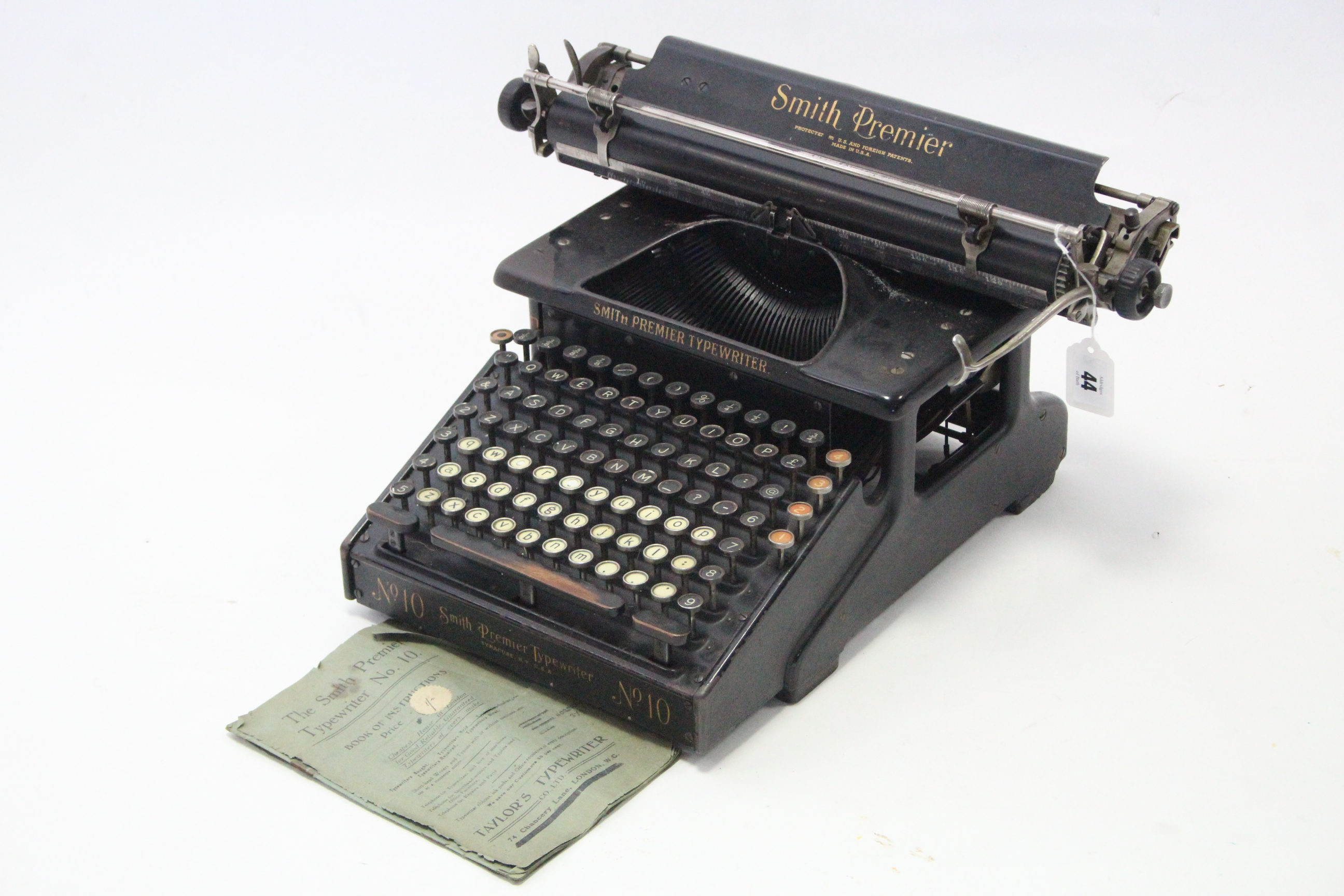 """Lot 44 - A vintage Smith Premier """"No. 10"""" typewriter, with cover."""