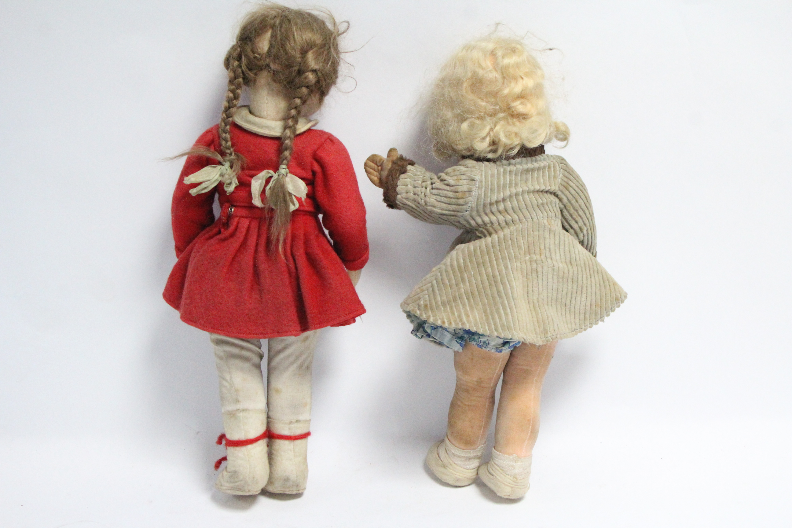 """Lot 283 - Two Lenci-type cloth girl dolls, both dressed, both 14"""" tall."""