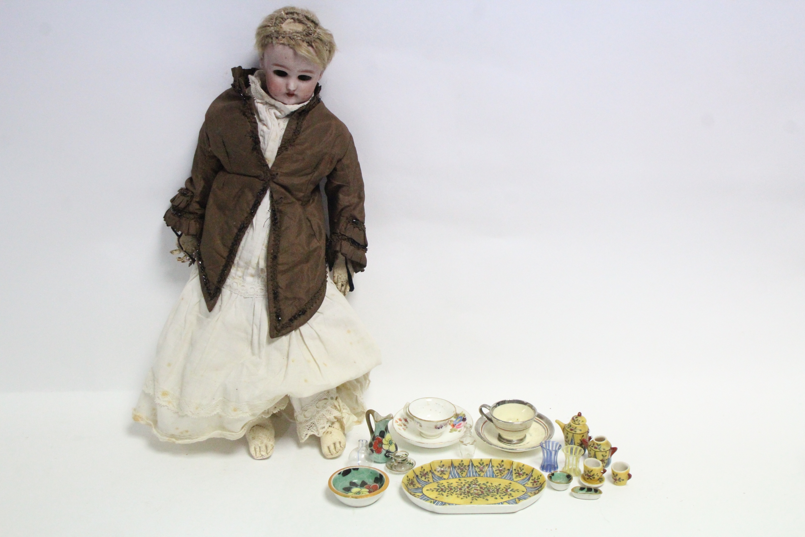 A German bisque head girl doll (41019 D. E. P.) with sleeping eyes, painted features & kid leather