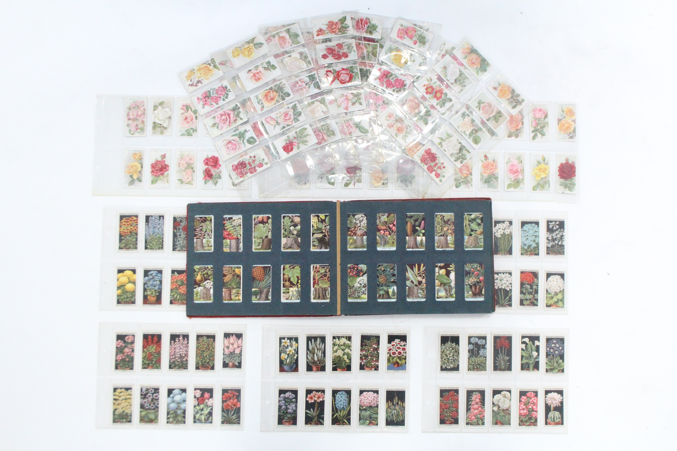 Lot 131 - Various W. D. & H. O. WILLS cigarette cards, in one album & on loose leaf pages.
