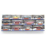 """Twelve various Matchbox """"Dinky Collection"""" scale model cars, each with window box."""