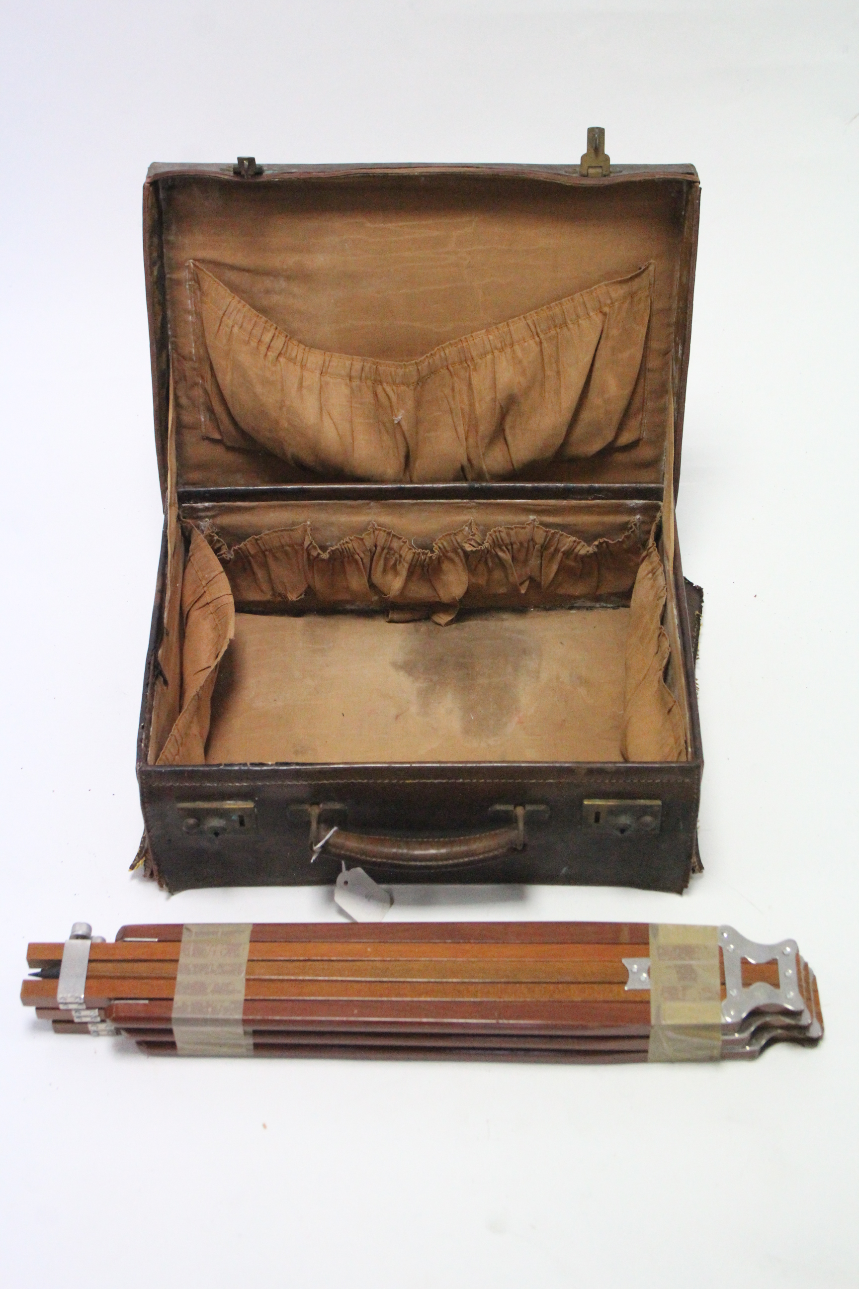Lot 30 - An early 20th century small leather suitcase, fitted brass twin-lever locks; & a mahogany folding