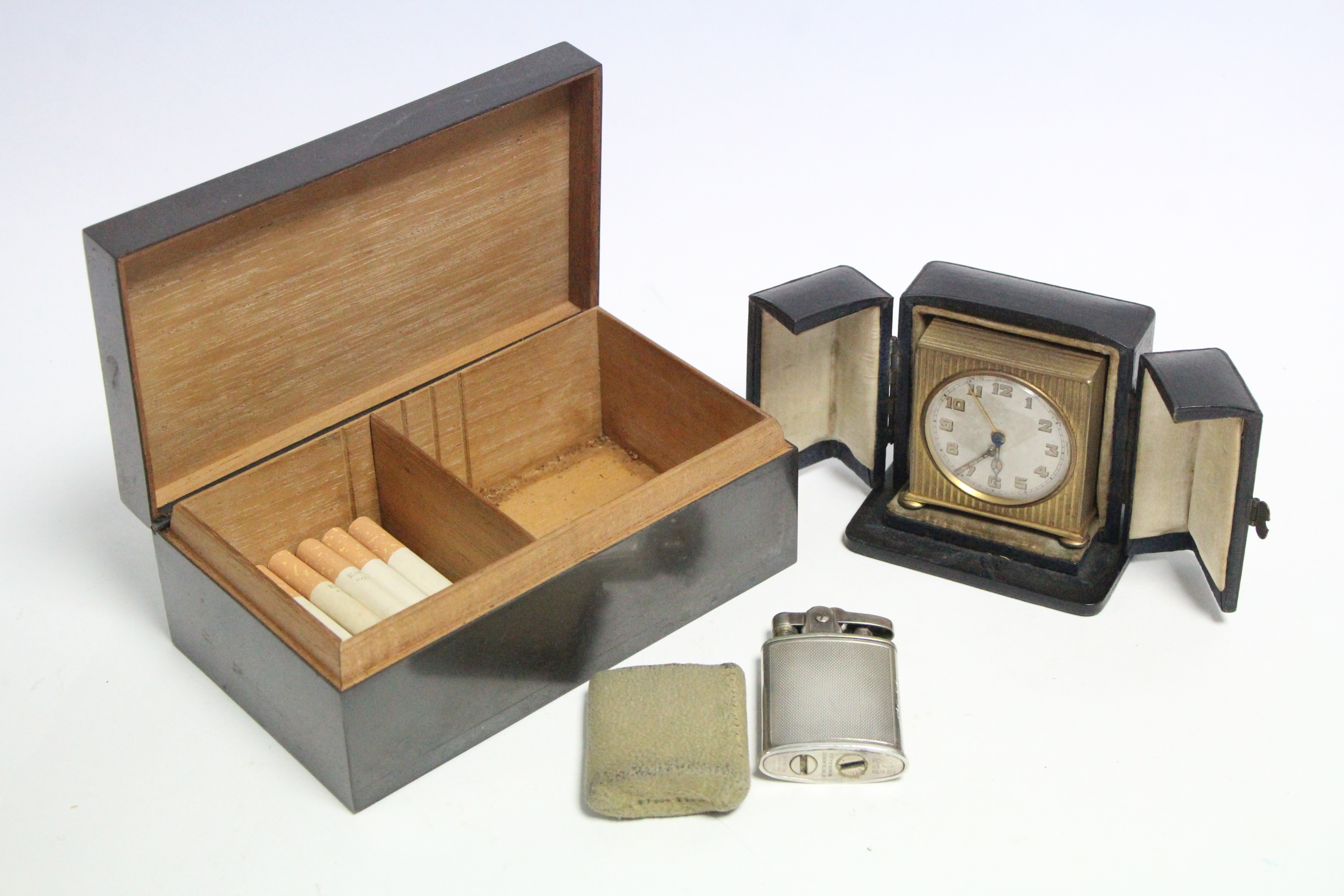 Lot 197 - *PLEASE NOTE AMMENDED DESCRIPTION/IMAGES* A 1940's Ronson plated cigarette lighter; a bronzed recta