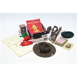 A Boy Scout leader's wide-brimmed hat; a Boy Scout's cap; various Boy Scouts belts & neckerchiefs,