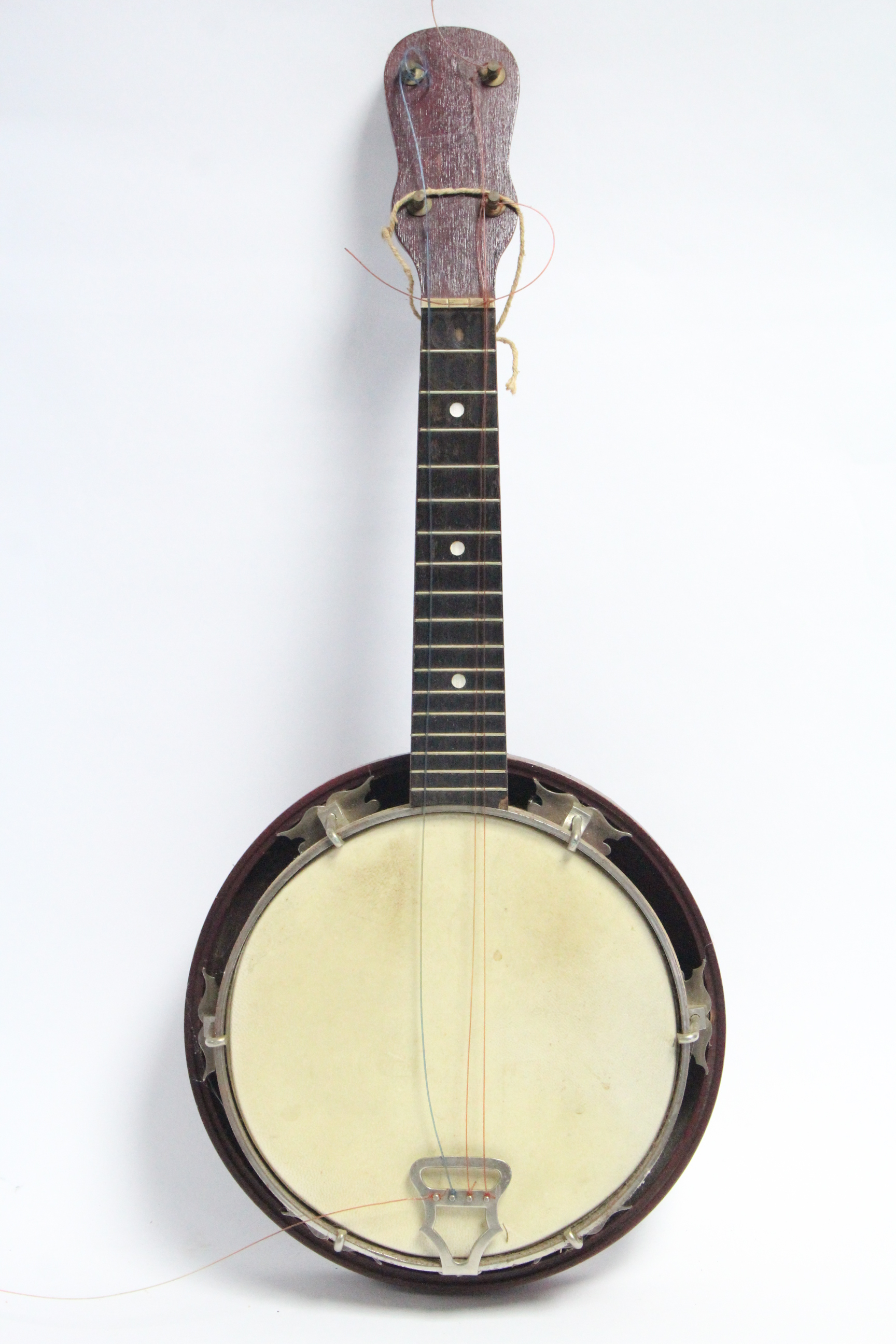"Lot 45 - A banjo, 21¾"" long, in black fibre-covered case."
