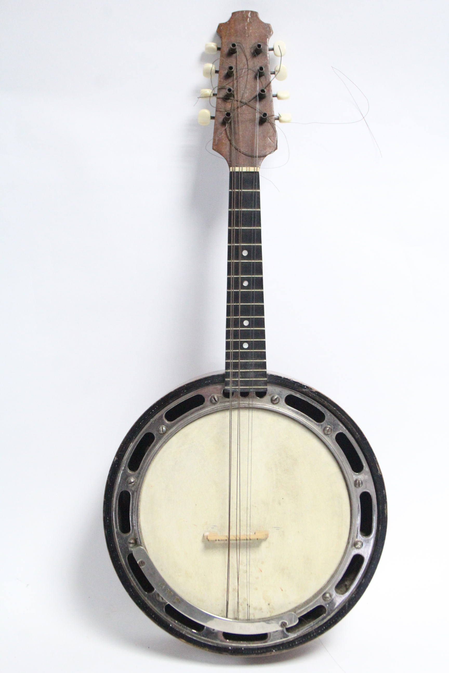 "Lot 49 - A banjo, 24"" long (lacking travelling case)."