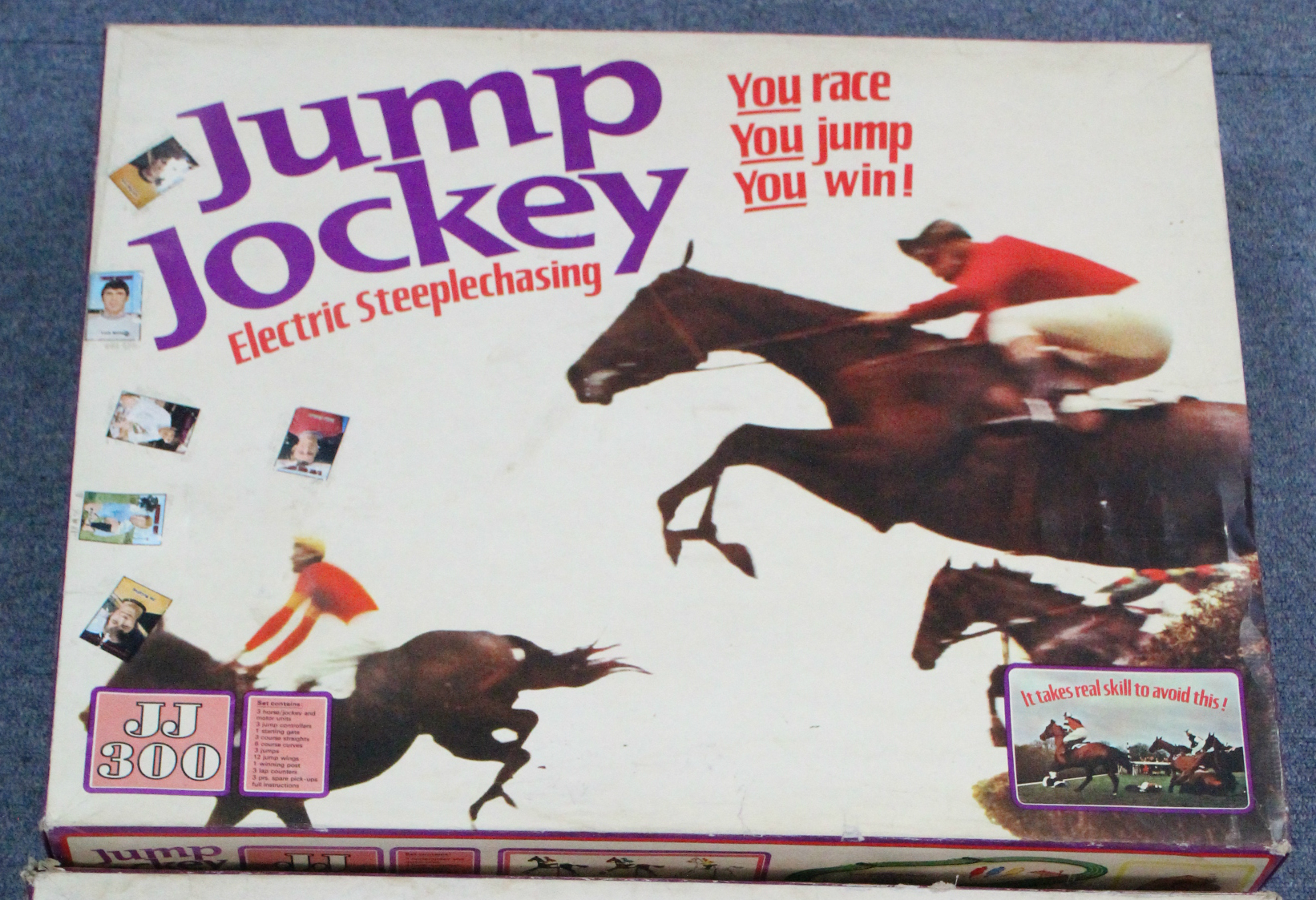 "Lot 302 - A Tri-ang ""Jump Jockey"" electric steeplechase game; & a Merit ""Electric Derby"" horse racing game"