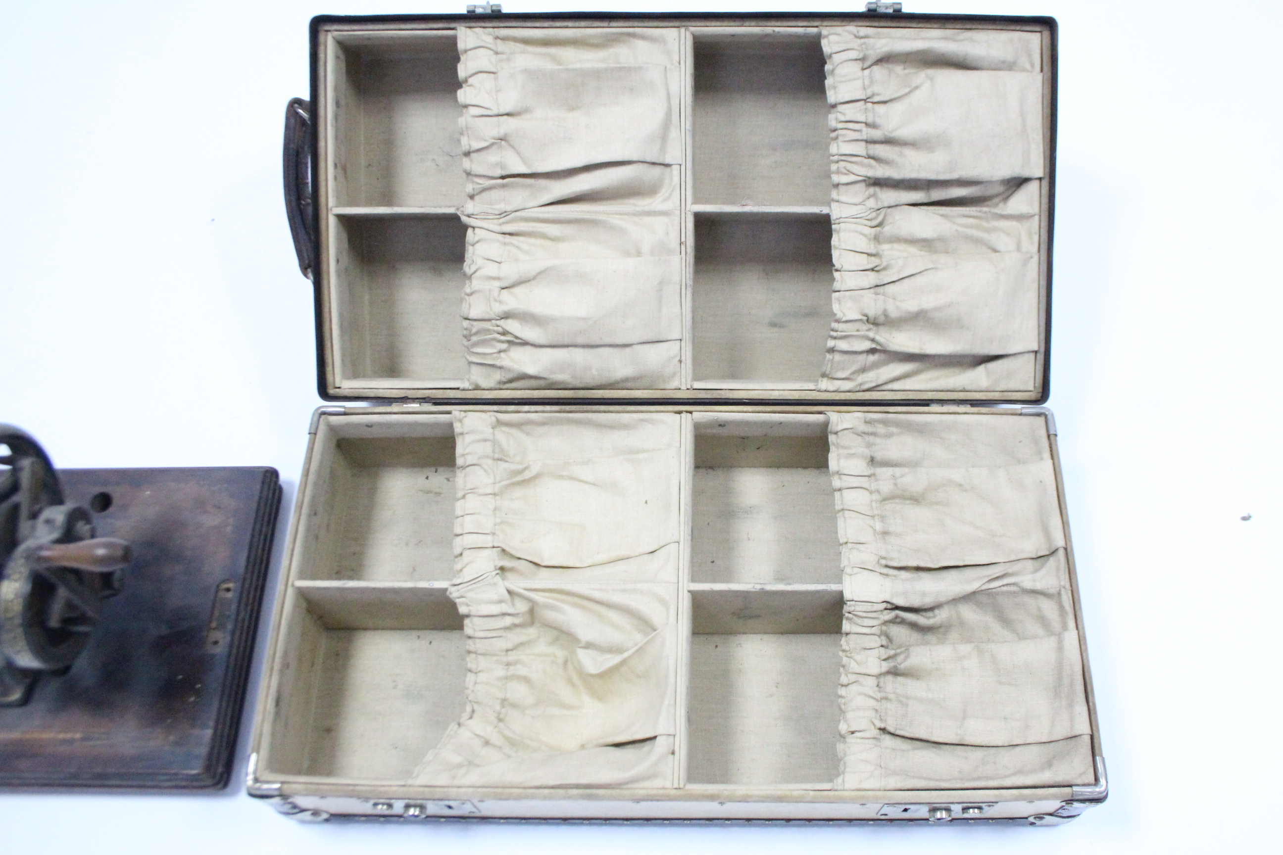 Lot 15 - An early-mid 20th century fibre-covered & steel-bound child's travelling trunk with hinged lift-lid,