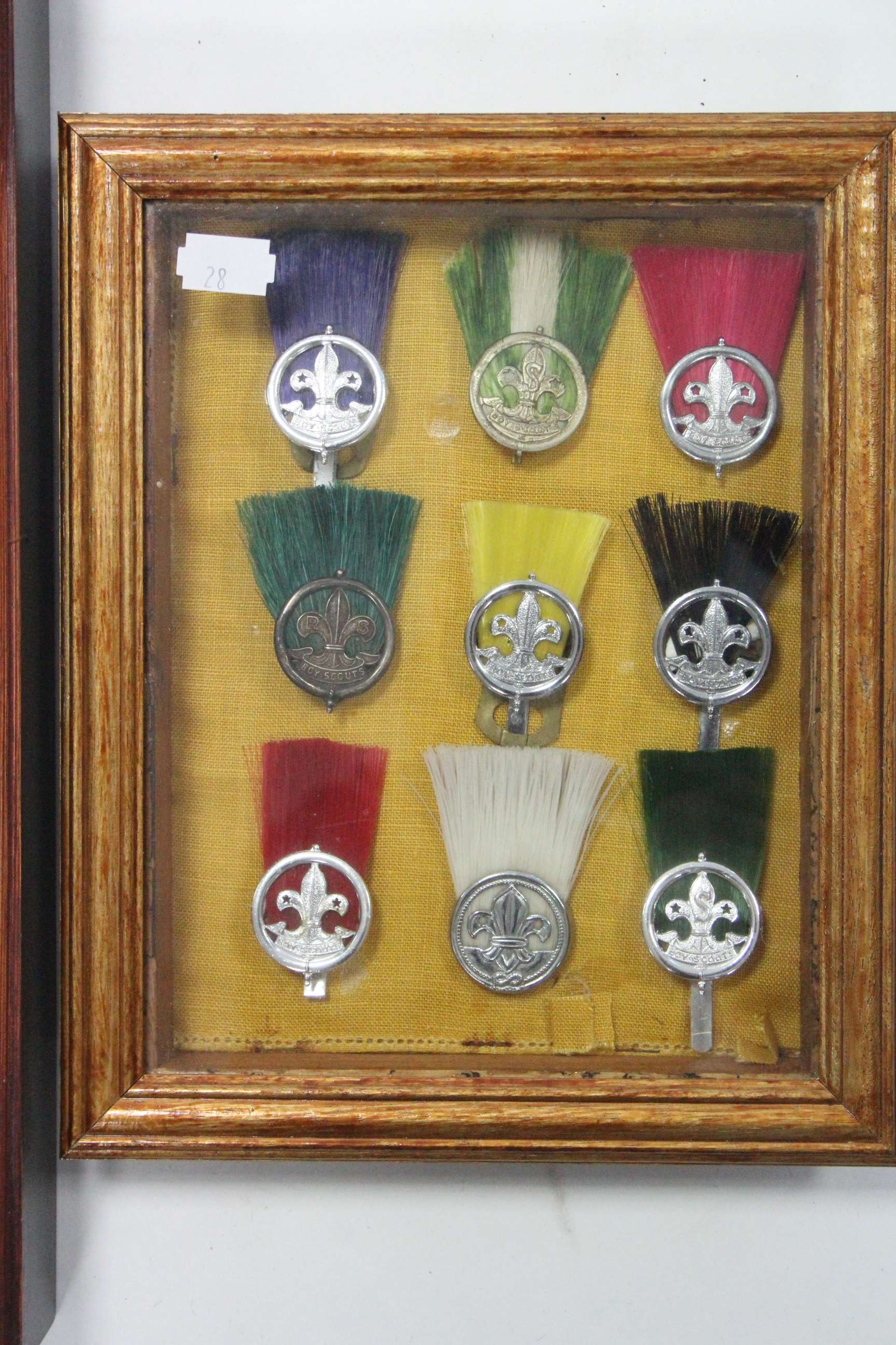 Lot 28 - A collection of approximately eighty various Boy Scout badges & tunic buttons, contained in three