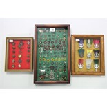A collection of approximately eighty various Boy Scout badges & tunic buttons, contained in three