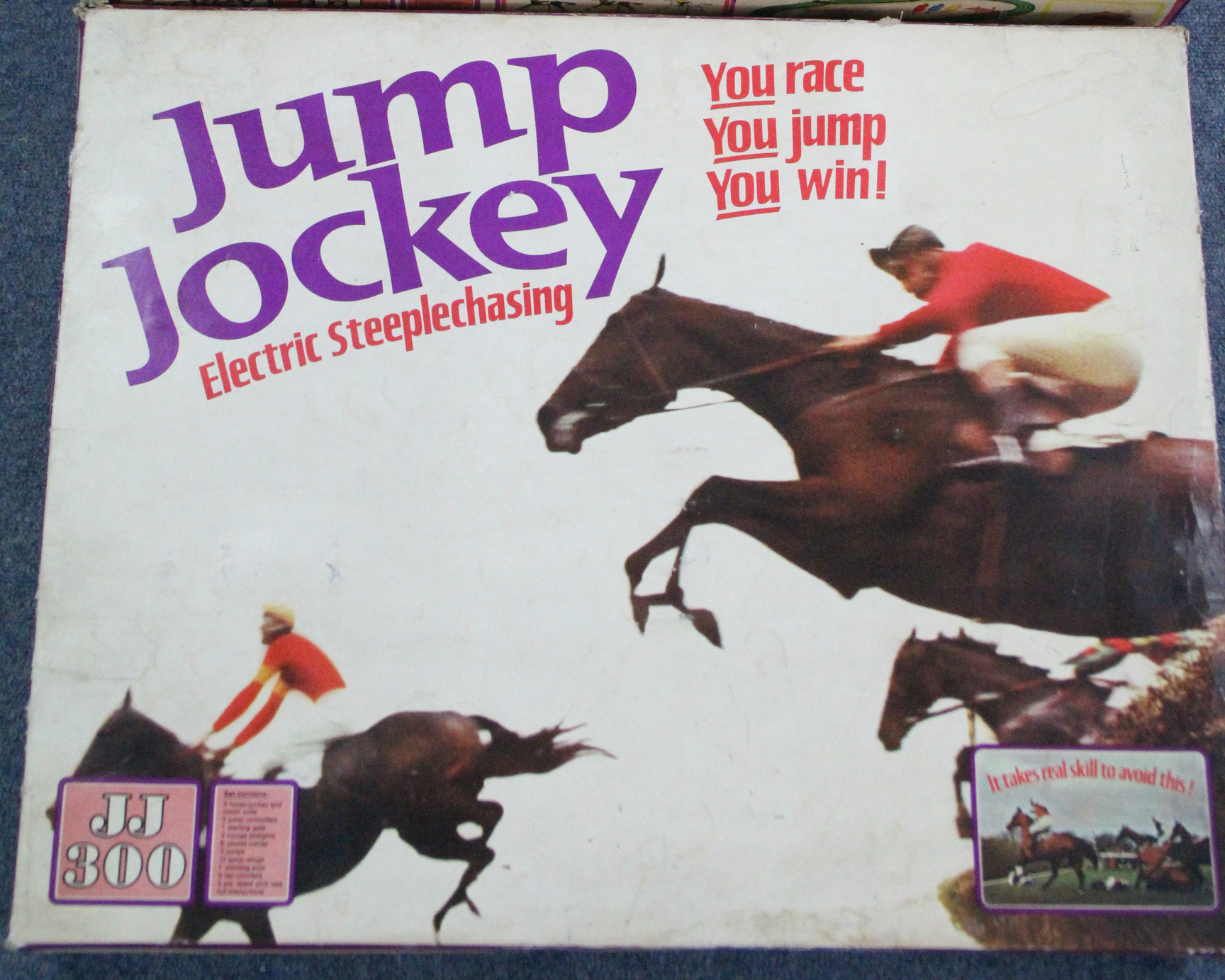 "Lot 303 - Another Tri-ang ""Jump Jockey ""electric steeplechase game, boxed; various Scalextric items; & various"