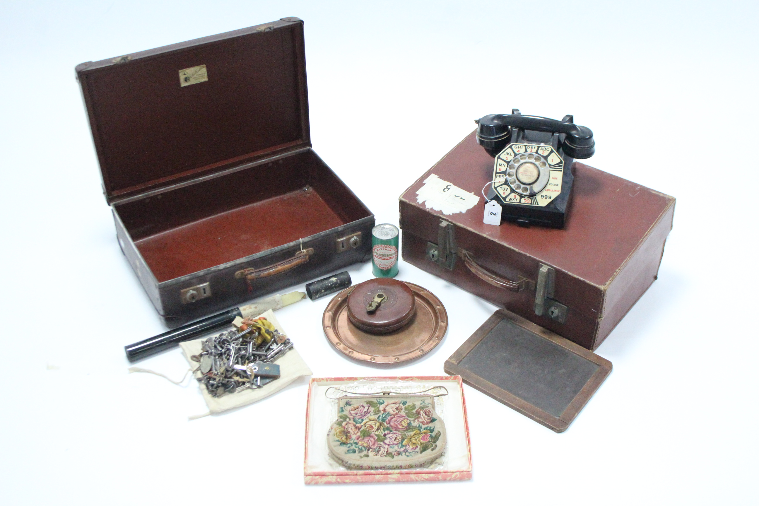 A vintage G. P. O. black Bakelite telephone; two fibre-covered suitcases; a Grown Brand child's