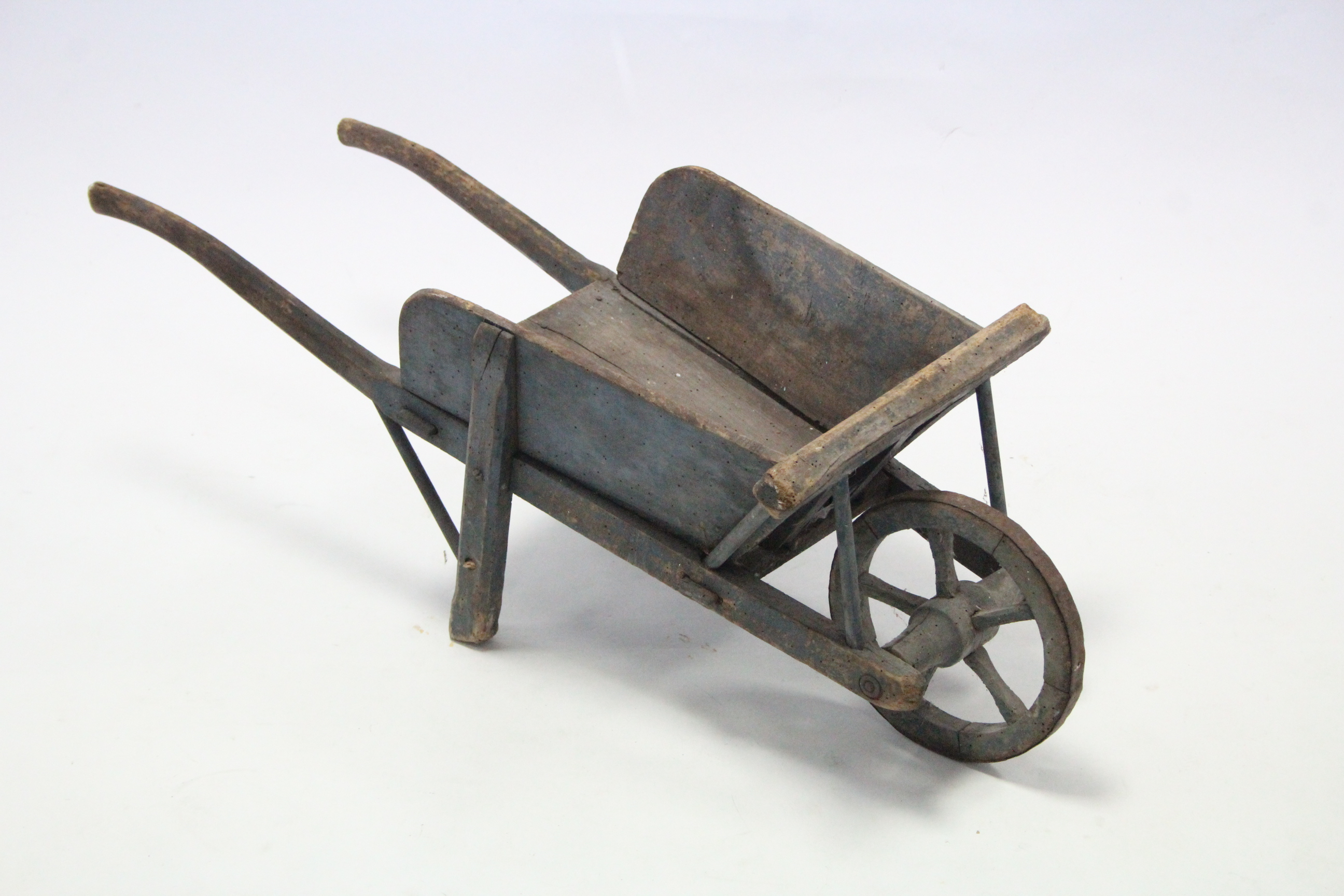 "Lot 312 - A painted wooden child's wheelbarrow, 31¾"" long, (w.a.f.)."
