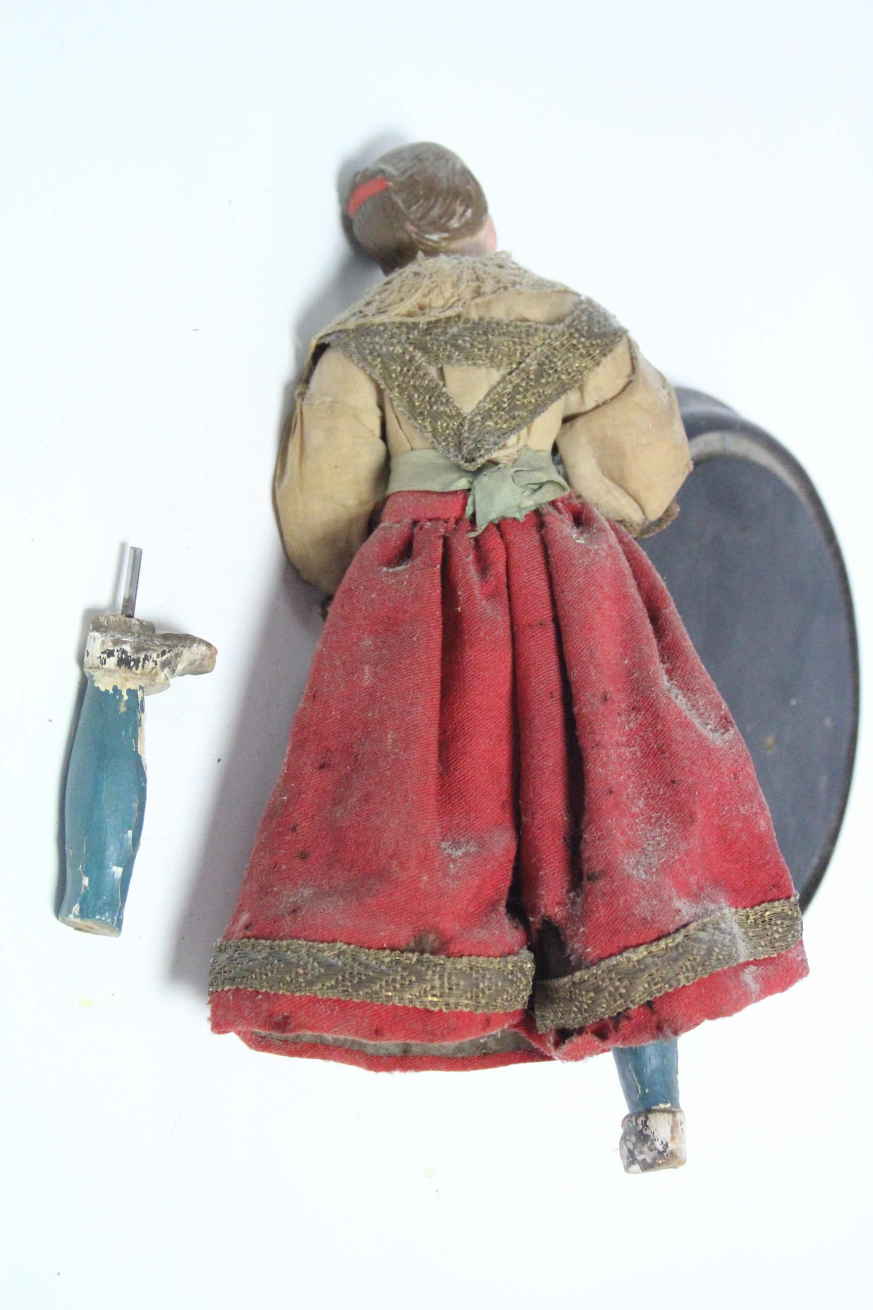 """A painted composition peddler doll mounted on ebonised wooden plinth, 11½"""" high. - Image 2 of 2"""