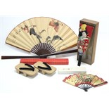 A Japanese cloth hand puppet in glazed deal case; two Japanese fans; & a pair of Japanese sandals.