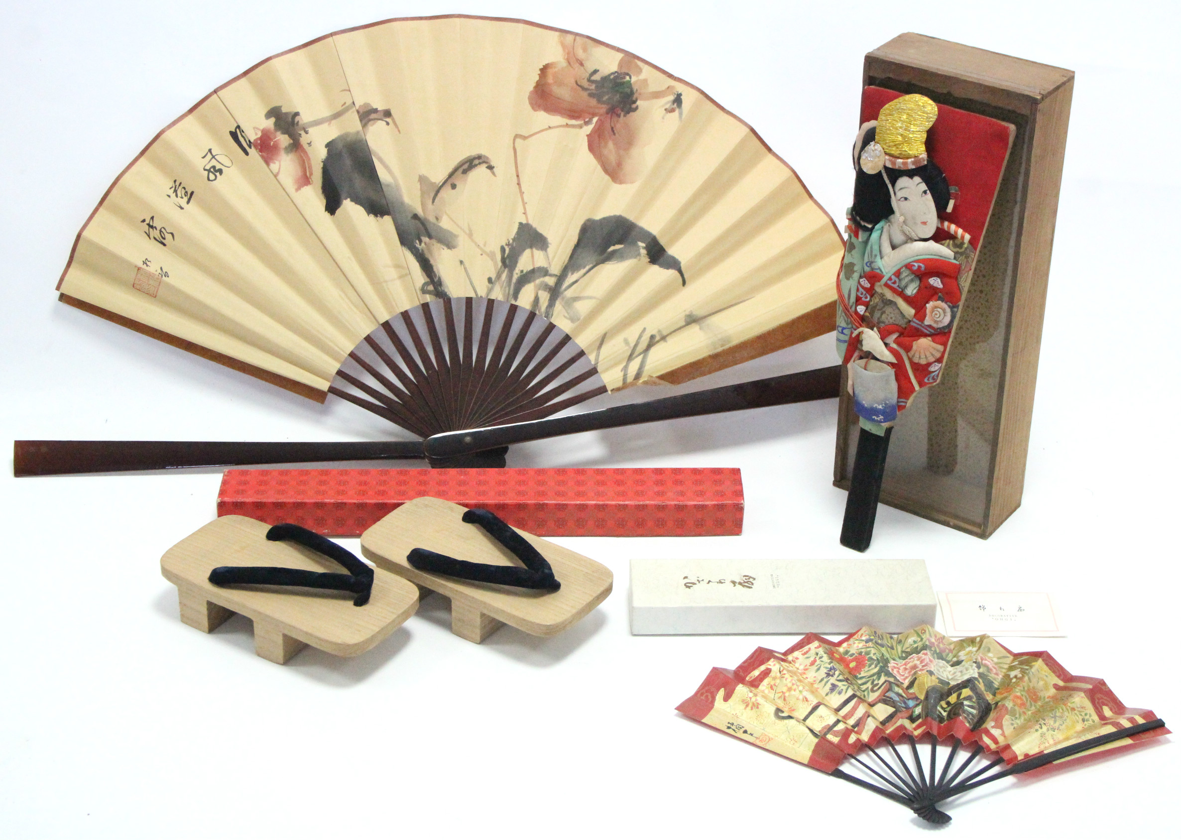 Lot 182 - A Japanese cloth hand puppet in glazed deal case; two Japanese fans; & a pair of Japanese sandals.