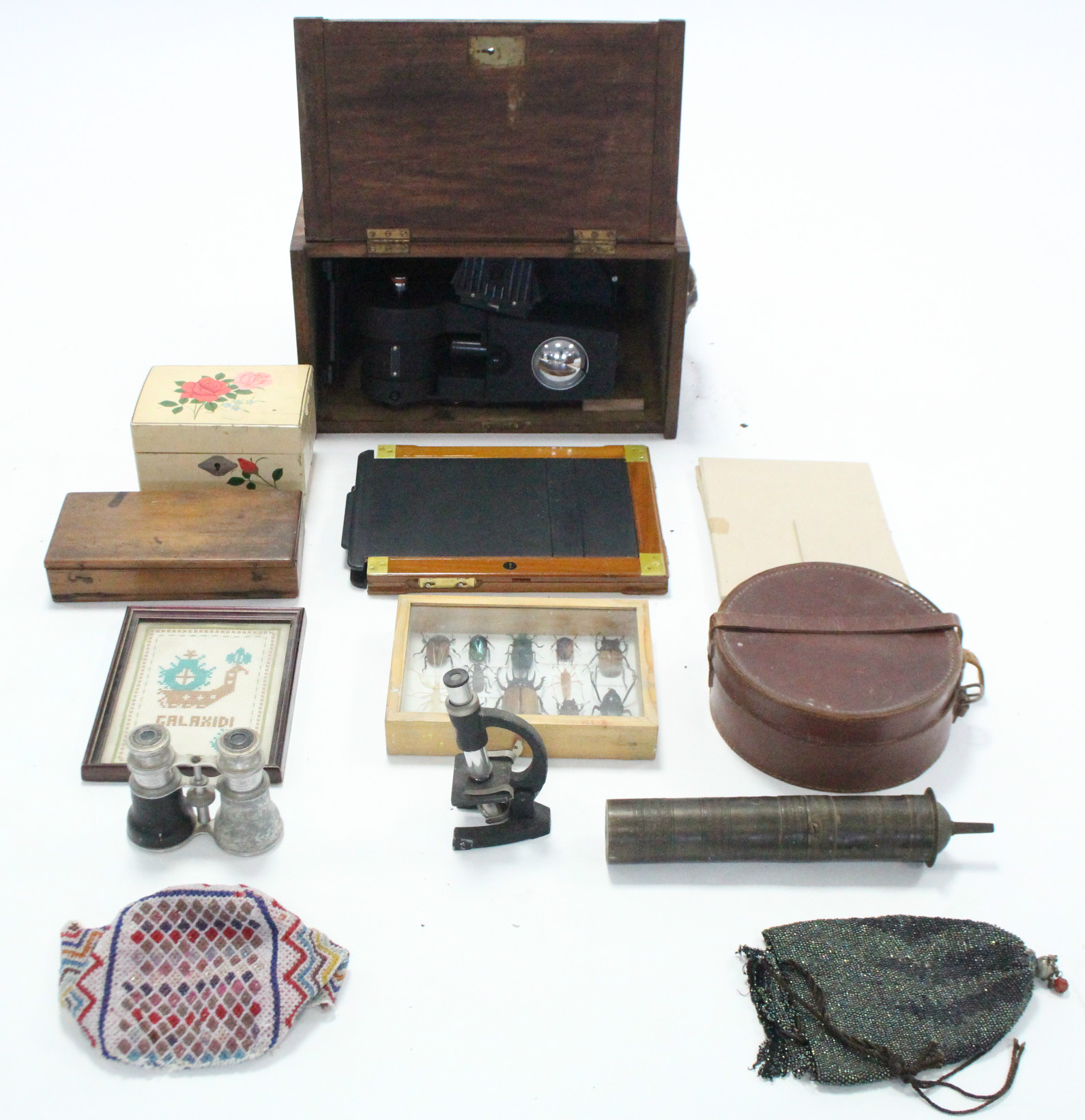 Lot 16 - A Pathescope film projector in mahogany case; a leather collar box; a Garran brass spit-roasting