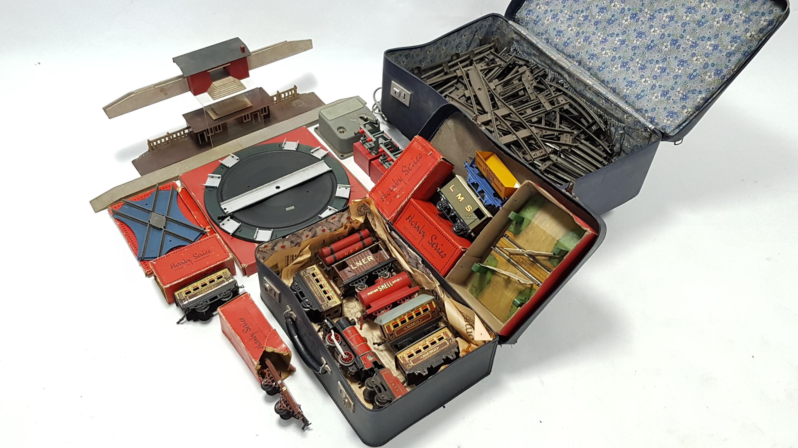 "Lot 275 - A Hornby Railways tinplate clockwork-operated ""OO"" gauge scale model of an 0-4-0 locomotive &"
