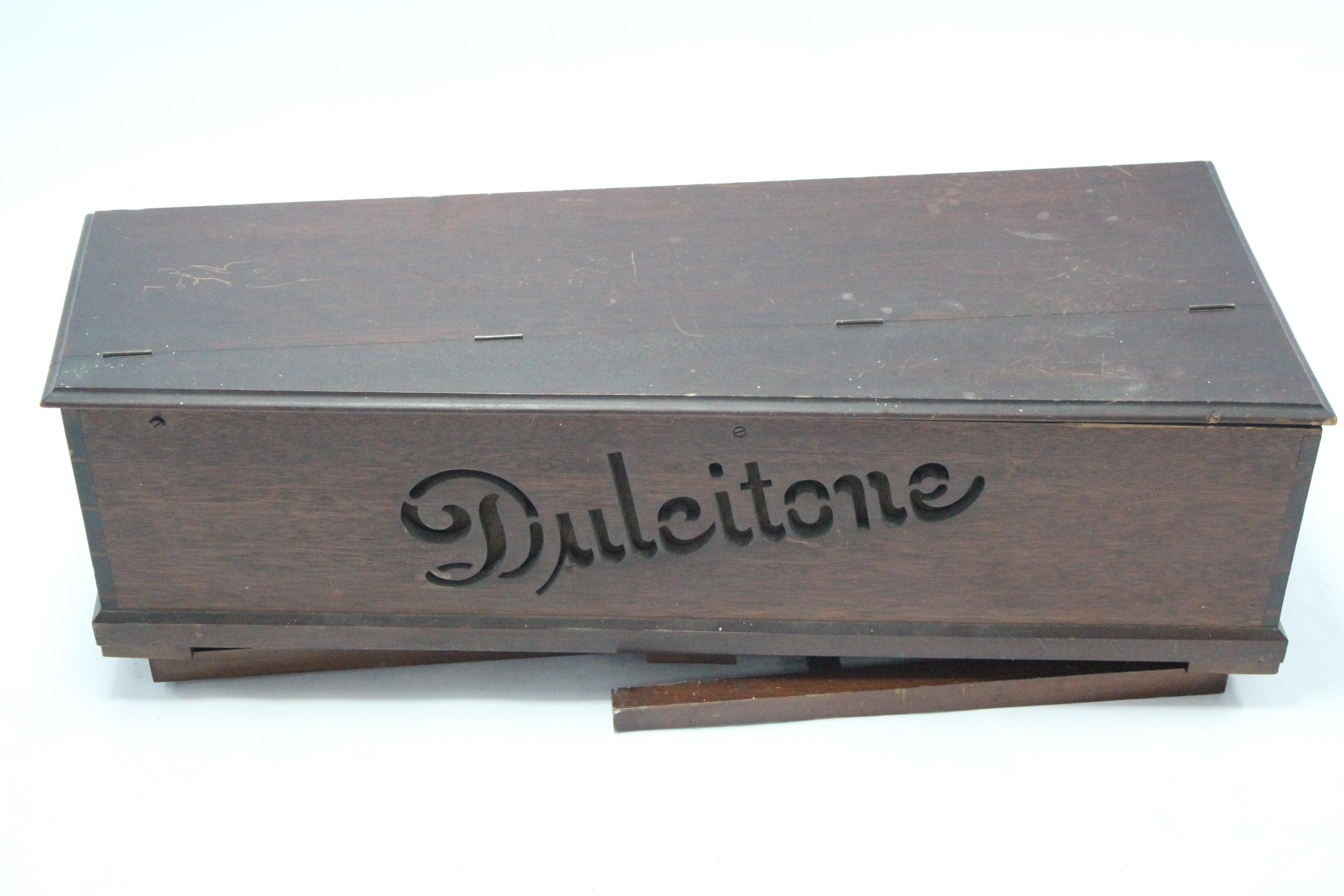 """Lot 52 - A Thomas Machell of Glasgow Dulcitone in oak case, & on fold-away legs, (legs w.a.f.), 38"""" wide."""