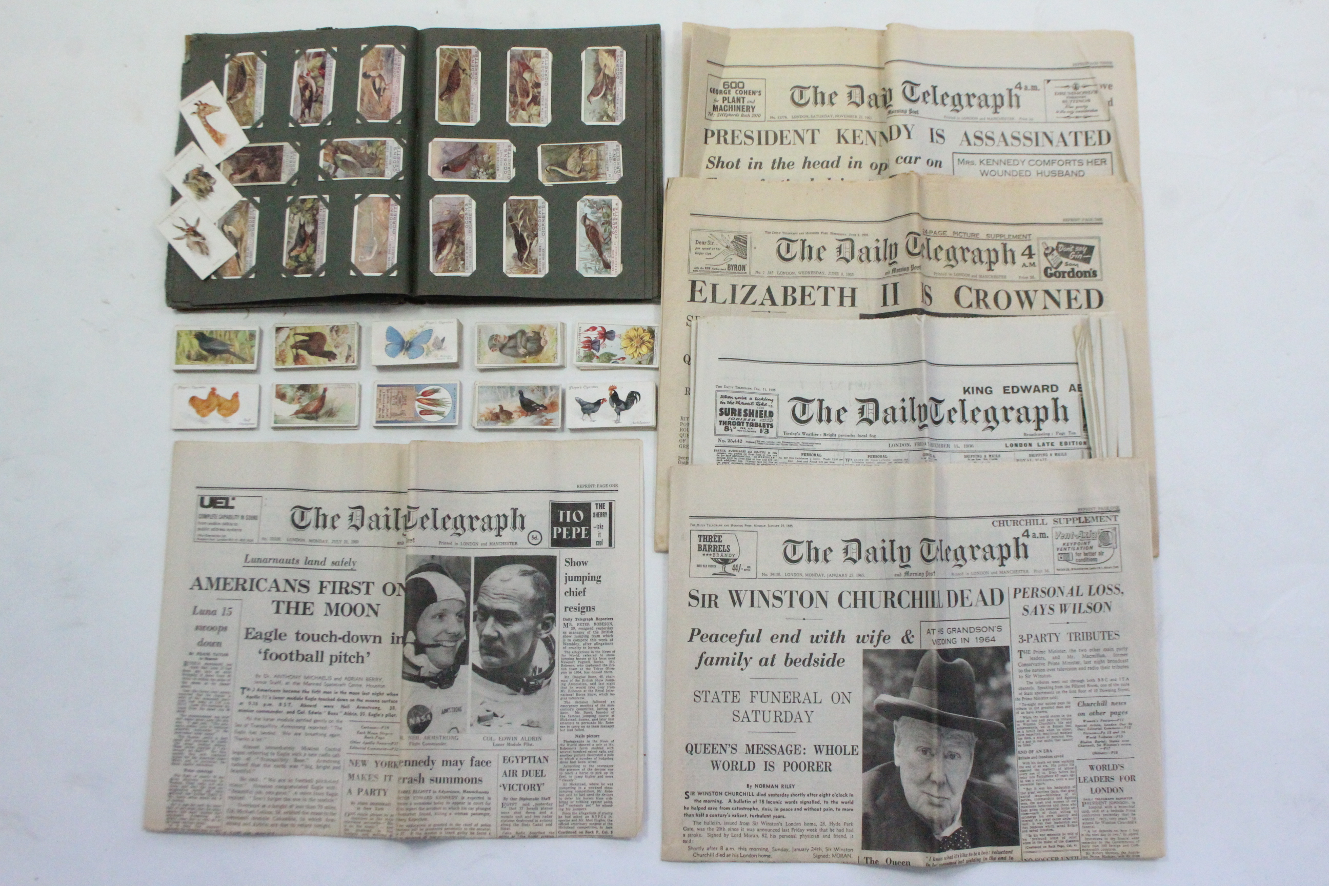 Lot 135 - Various mixed cigarette cards, in one album & loose; & various vintage newspapers.