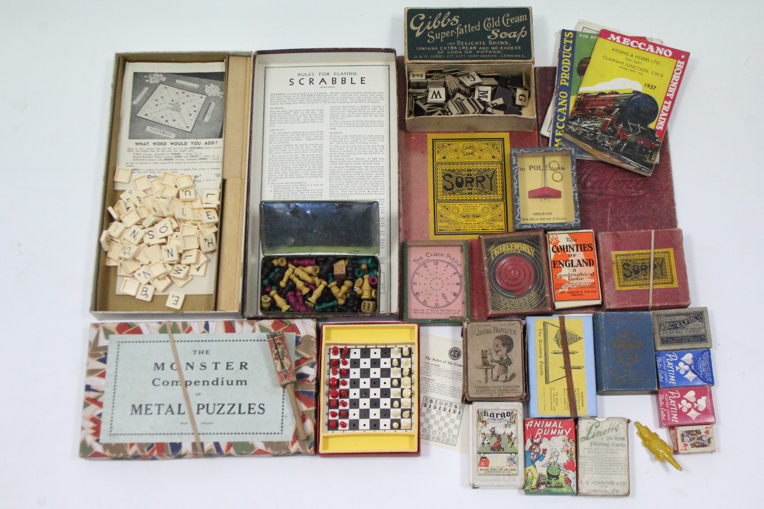 """Lot 282 - The Monster Compendium of Metal Puzzles"""", boxed, circa early-mid 20th century; together with various"""