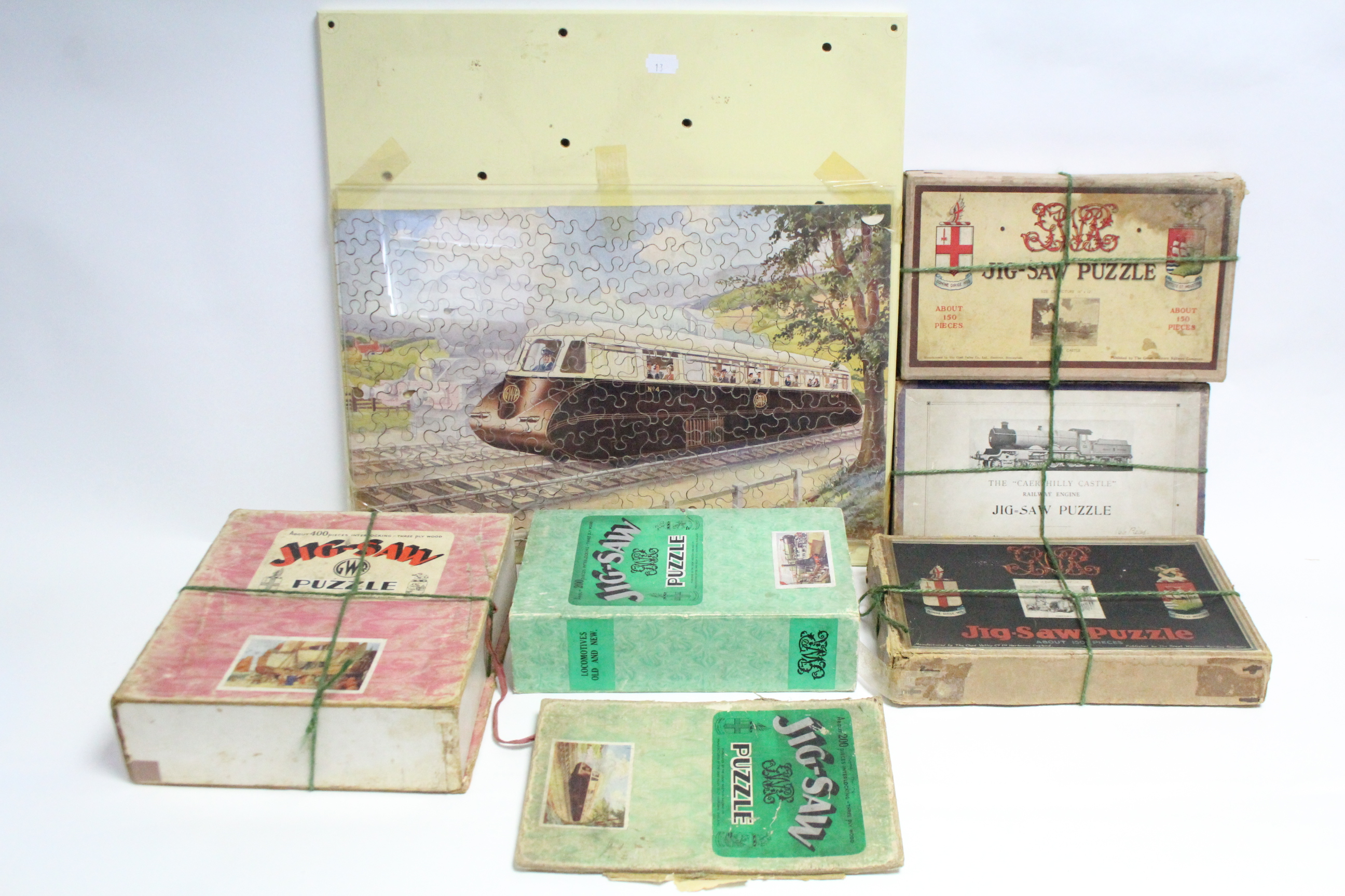 """Lot 293 - A Chad Velley GWR jigsaw puzzle """"The Streamlined Way"""" (assembled, complete); & five other Chad"""