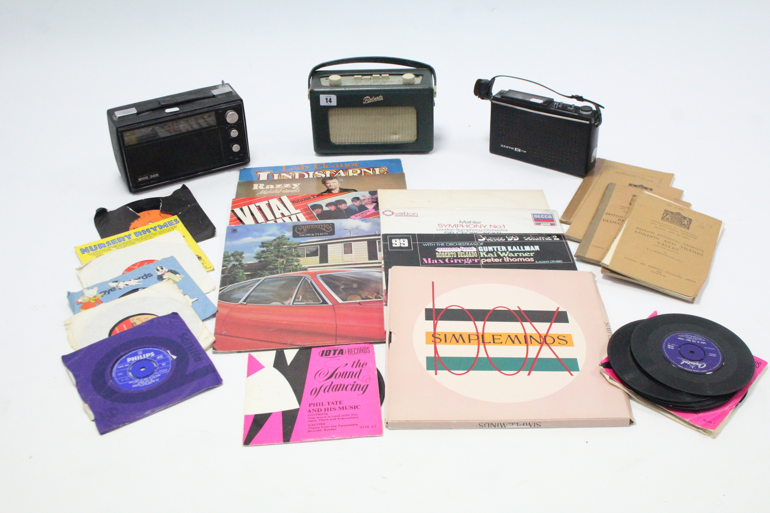Lot 14 - Three portable radios; & various records.