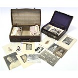 A collection of loose family photographs; together with two leather suitcases; & approximately