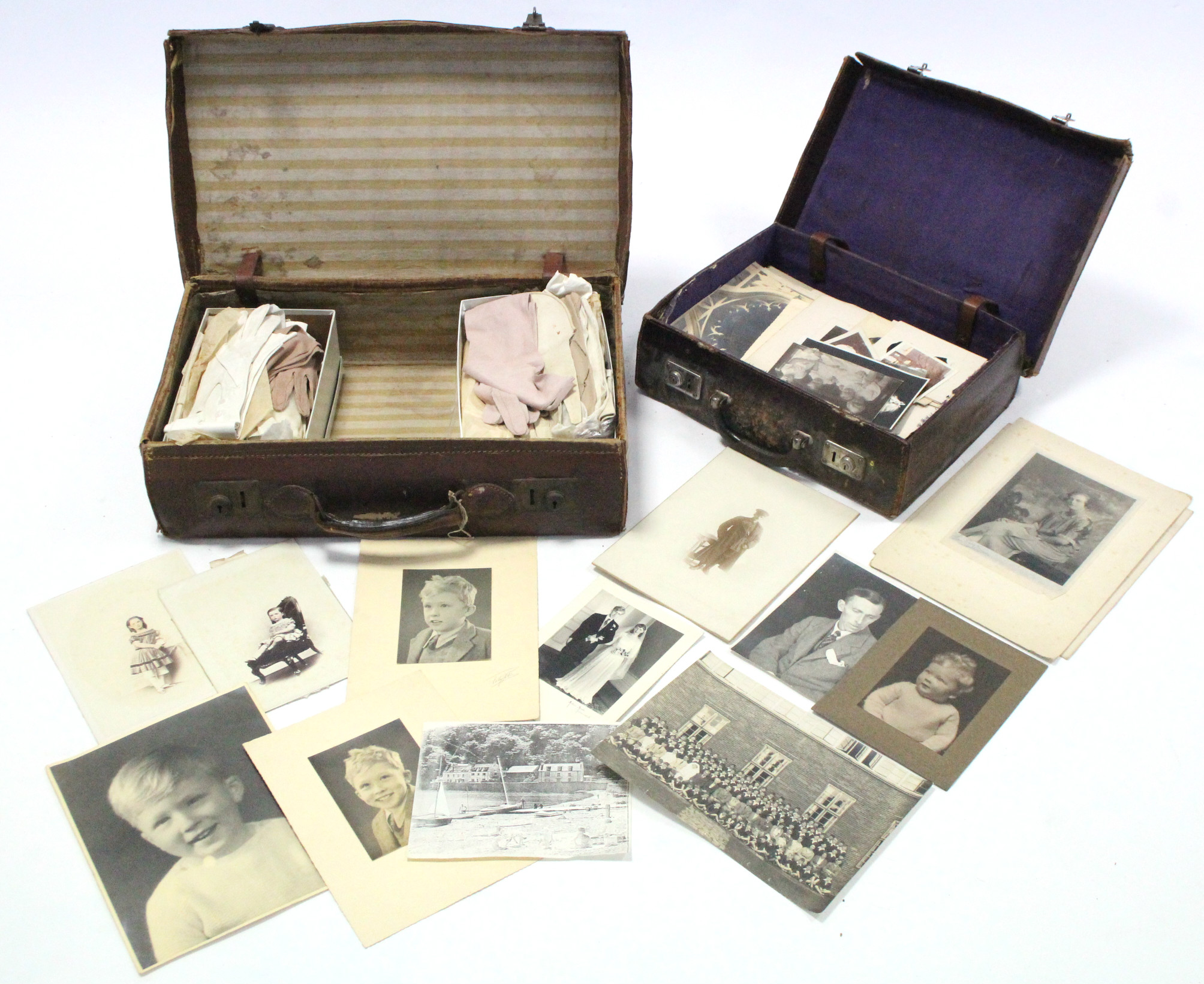 Lot 18 - A collection of loose family photographs; together with two leather suitcases; & approximately