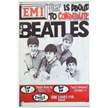 "A reproduction aluminium rectangular sign ""EMI IS PROUD TO CONGRATULATE THE BEATLES"", 11¾"" x 7¾""."