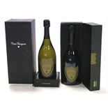 "Two bottles of Moet et Chandon ""Dom Perignon"" champagne (1998 & 1999, 750ml), both boxed."