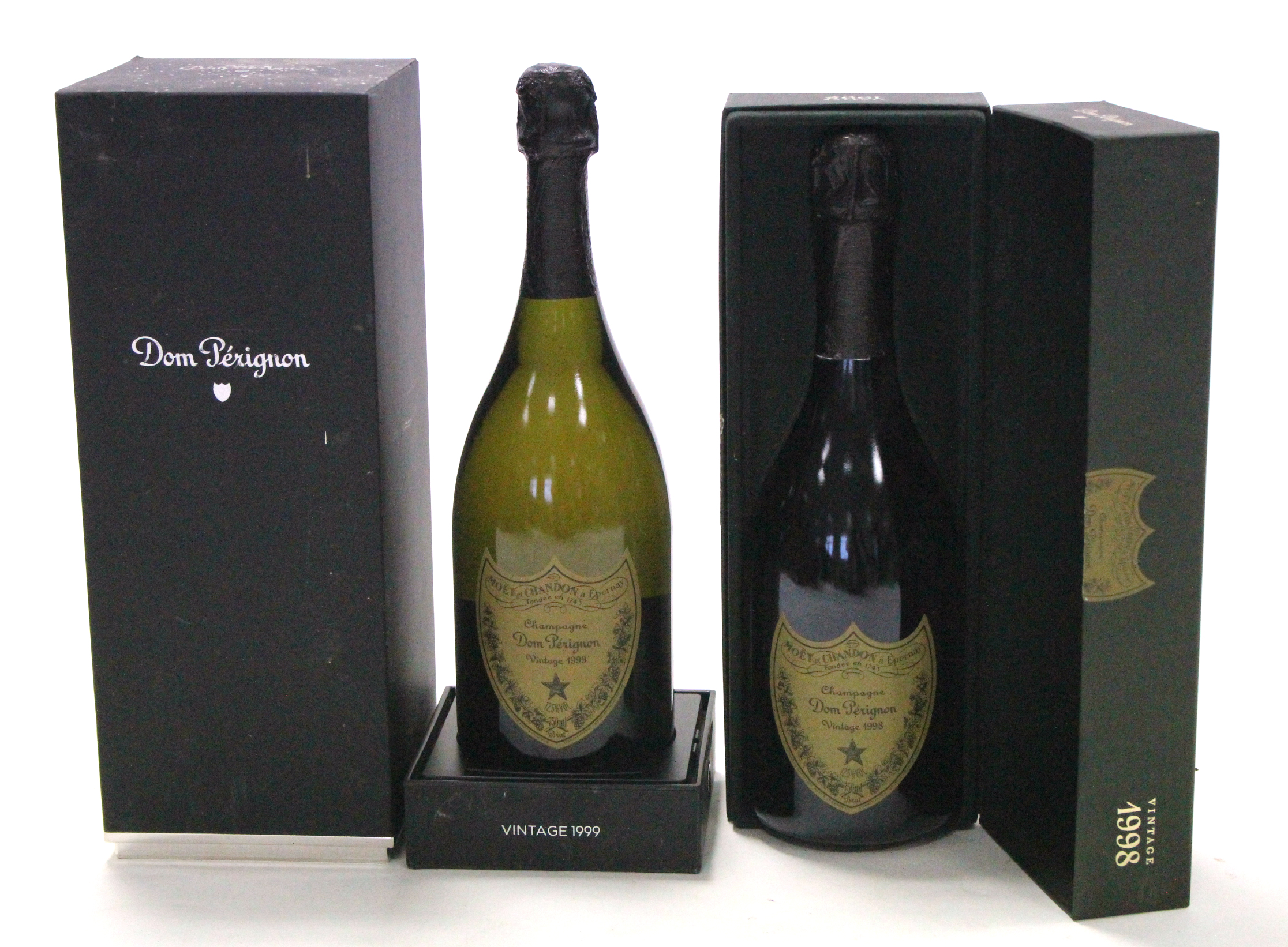 "Lot 58 - Two bottles of Moet et Chandon ""Dom Perignon"" champagne (1998 & 1999, 750ml), both boxed."